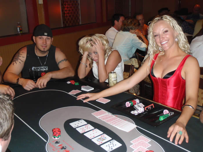 Jaime dealing Texas Hold'em in her red corset