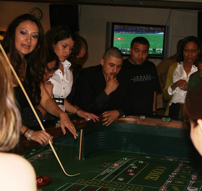 Teaching craps at the Luke Air Force Base's Holiday Party